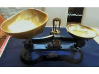 Vintage cast iron kitchen scales by Boots the Chemist with brass pans and solid brass weights