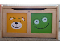 Toy chest in natural wood by Pintoy this beautiful toy box has a child safe hinge & colourful design