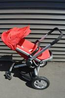 Red Quinny Buzz 4 Stroller with accessories