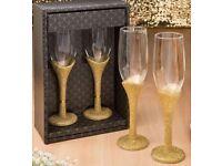 Gold egegance toasting champagne flutes