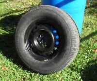 Roue neuve- pneu usagé 50 % pour Cherokee 2005 gr 225-75-R16