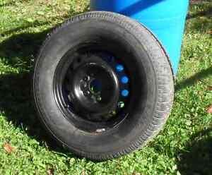 Roue neuve- pneu usagé 50 % pour Cherokee 2005 gr 225-75-R16 Québec City Québec image 1