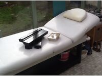 Solid wood massage bed. Height adjustable,shelf underneath, perfect for clients clothes, towels etc.