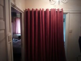 Pair of red velvet, lined, eyelet curtains 90 inch wide 90 inch drop