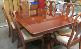 large solid table and 6 chairs
