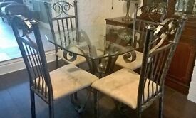 Lovely Glass Top Metal Table and 4 matching Chairs in very good condition.