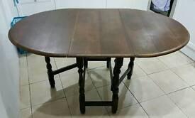 Dark oak drop-leaf dining table