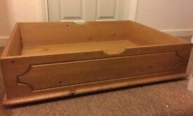Under-bed pine storage drawer on wheels
