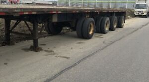 2003, 4 Axle Flatbed 48' Trailer. 2 Lift axles good condition