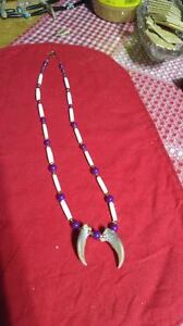 unique one of a kind bear claw necklaces -