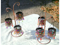 Tea Lights on decorative metal stand. They are brand new, unwanted gift
