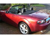 A great example of this popular sports car - Mazda MX-5 in copper red