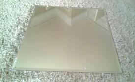 Square mirror with bevelled edge