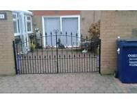 Heavy wrought iron gates