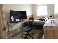 Office desk with chair and rug
