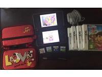 Nintendo DSi XL + 5 games