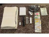 NINTENDO WII CONSOLE WITH WII FIT BOARD AND 5 GAMES