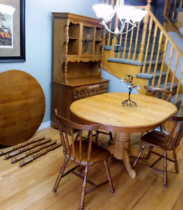 Dining Set  includes Hutch 4 solid chairs and bonus table.