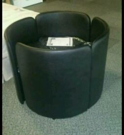 A brand new set of 4 black leather effect storage dinning chairs.