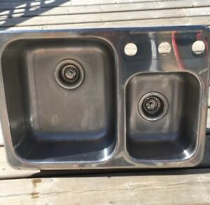 Stainless steel kitchen sink and a half