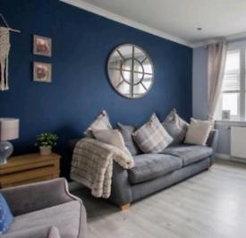 Grey Sofa with Tartan Cushions