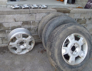 Set of 4 Ford 6-bolt F150 rims. Includes 2 good tires