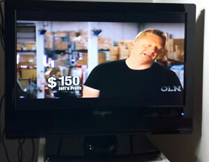 19 inch LCD TV with original remote. $50.00 includes...