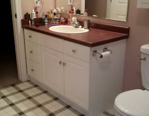 White vanity with countertop, sink and taps