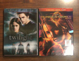 2 DVDs Twilight, Hunger Games, both 2 DVD sets