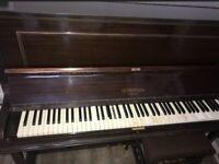 J.J Hopkins Upright Piano with matching stool.