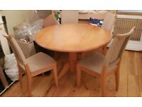 """Beech round dining table approx 41"""" across and 4 matching chairs. Good used condition"""