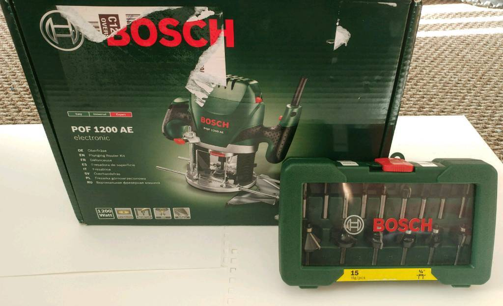 Bosch pof 1200 ae router with 15 piece router bit set never used bosch pof 1200 ae router with 15 piece router bit set never used greentooth