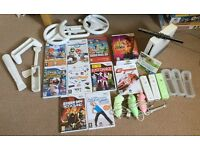 Nintendo Wii with games and equipment (WiiFit optional)