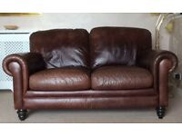 2 Leather 2 seater sofas. Good Condition