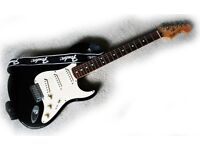 Fender Stratocaster in black with either hard case or soft Fender bag... 2002 and in good condition
