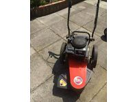 DR Heavy-duty Wheeled Strimmer powered by Briggs and Stratton 190cc petrol engine.
