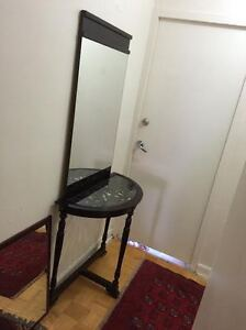 Dark brown half table with mirror.