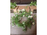 4 beautiful decorative daisy chains made by Bloom