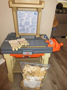 Tool bench with wood, tools and working gloves