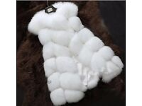 White faux fur body warmer