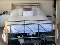 Double silver and wooden bed frame with mattress