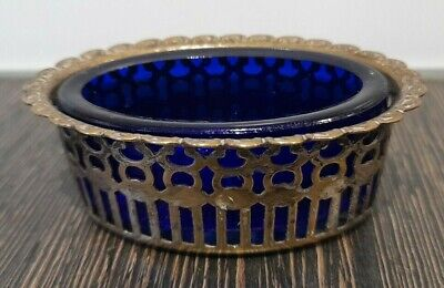 Vintage salt with blue glass liner
