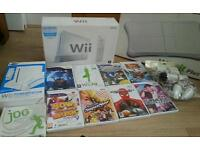 Nintendo wii complete console with Nintendo wii fit board Nintendo wii wheel and stand and games