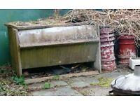 OLD SECTIONAL CONCRETE COAL BUNKER AND BROKEN CHIMNEY POTS