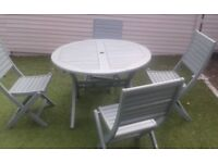 Green round wooden Garden Table and four Chairs - Foldable £45