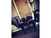 Black bucket chairs and table