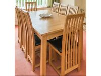 Willis and Gambier extending oak dining room table and 8 chairs.