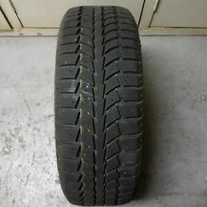 4 Uniroyal Tiger Paw II snow tires on steel rims