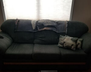 Couch and loveseat for sale green in colour