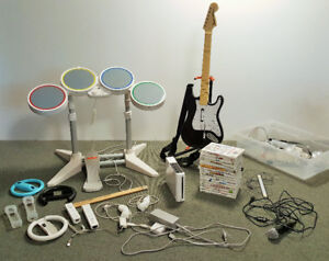 Wii Console, Controls, Drum Set, Guitar, Games, and Extras